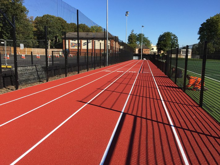 Completed project of synthetic turf pitch, tennis courts and athletics sprint track.